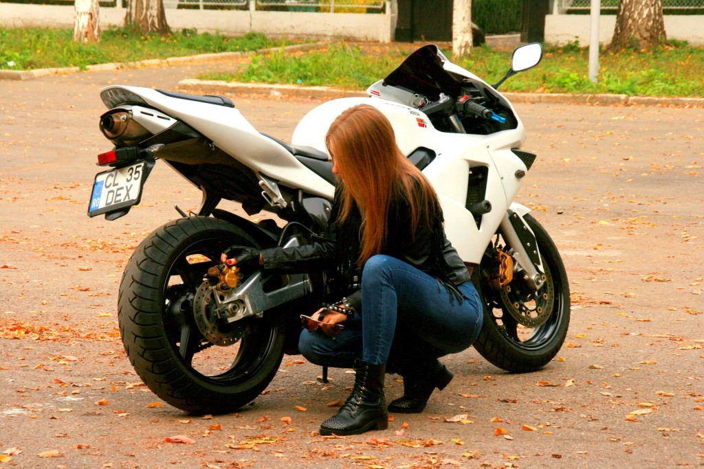 woman by motorcycle