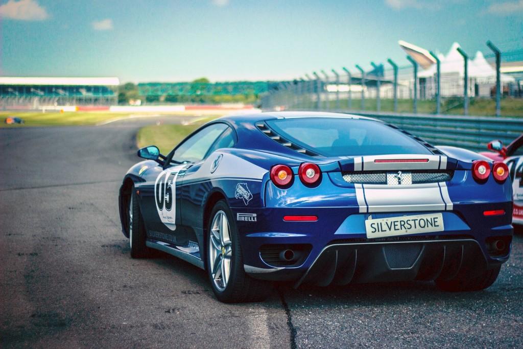 blue car on track
