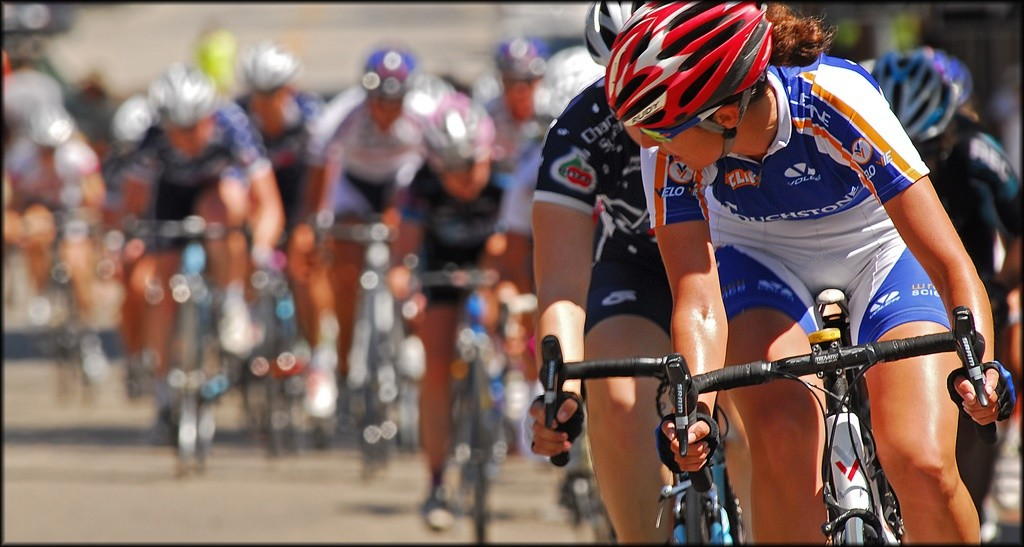 woman looking back at other cyclists